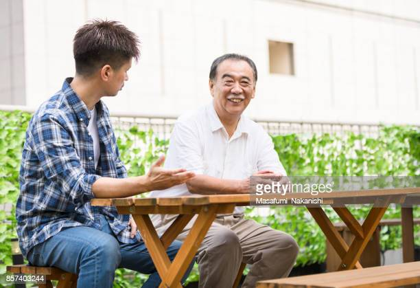 Family talking with an open garden