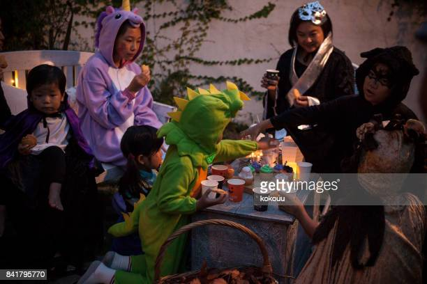 a family that is having a halloween party in the garden. - halloween party stock photos and pictures