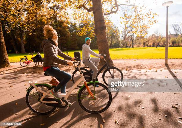 Family time in park on bikes.