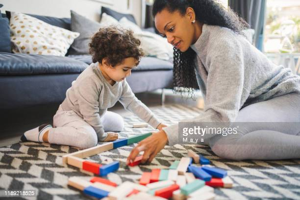 family time - board game stock pictures, royalty-free photos & images