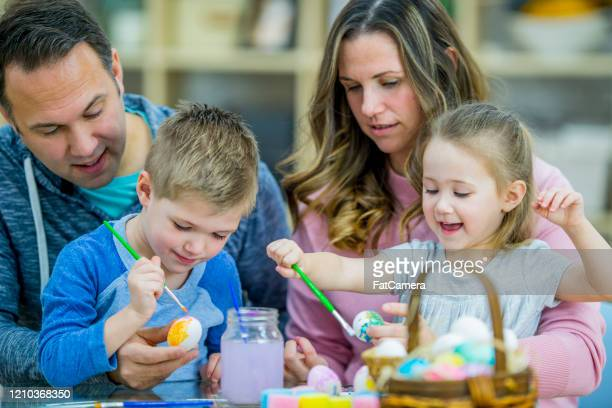 family time - easter basket stock pictures, royalty-free photos & images