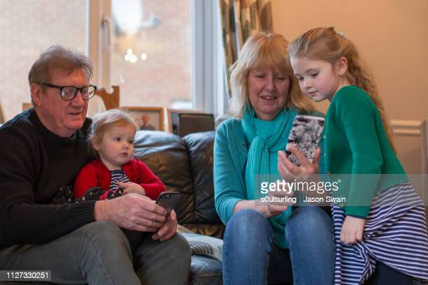 family time with technology - s0ulsurfing stock pictures, royalty-free photos & images