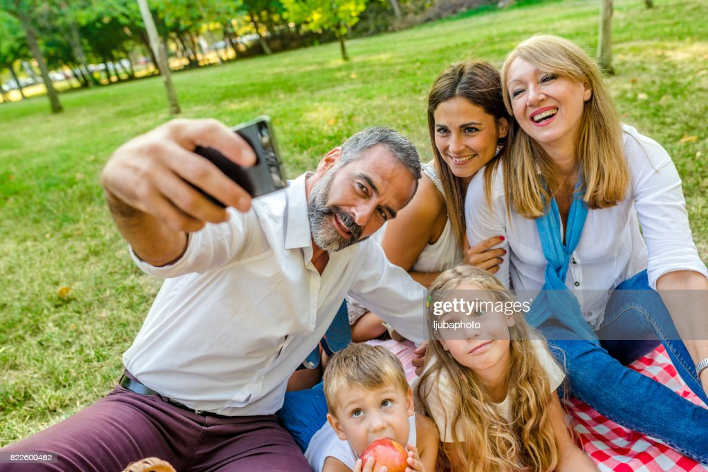 Family time wouldn't be complete without a selfie : Stock Photo