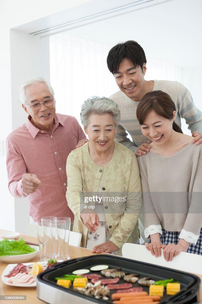 Family to roast meat : Stock Photo