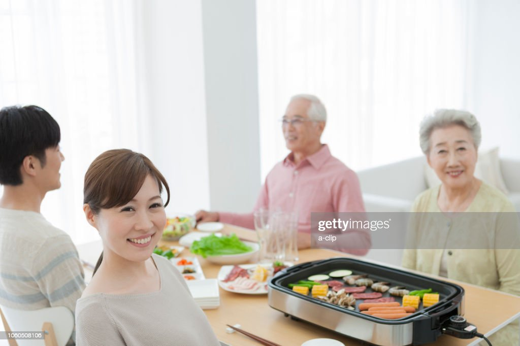 Family to roast meat : Stock Photo