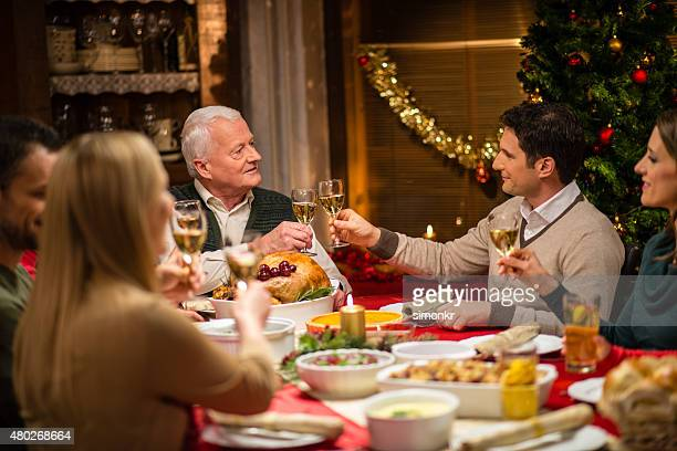 Family toasting at Christmas dinner