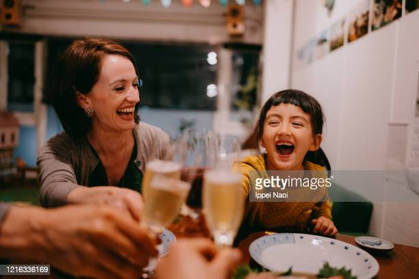 family toasting at dinner - evening meal ストックフォトと画像