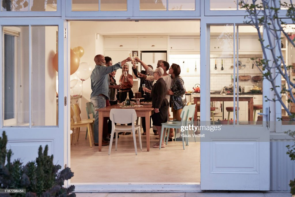 Family toasting drinks during birthday party : Stock Photo