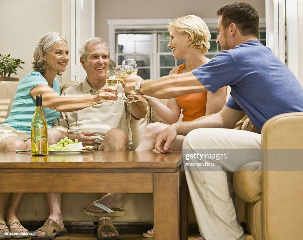 Family toasting in Living Room : Foto stock