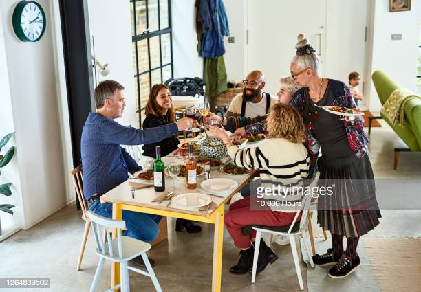 family toasting wine over dinner - lunch stock pictures, royalty-free photos & images