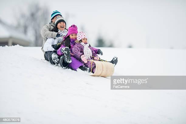 family tobogganing - tobogganing stock pictures, royalty-free photos & images