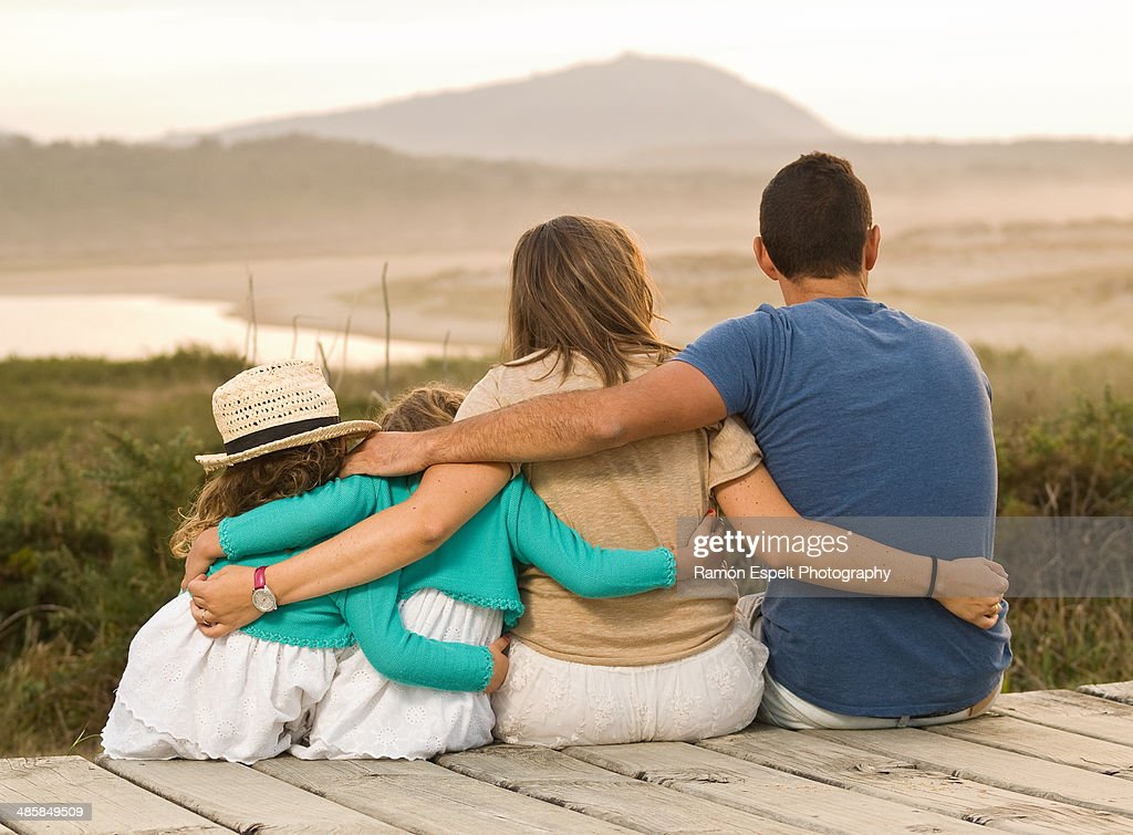 Family together and embracing : Stock Photo