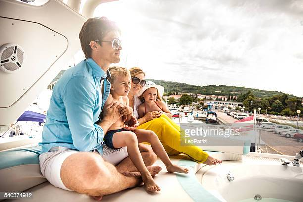 Family together on a boat in summer vacation