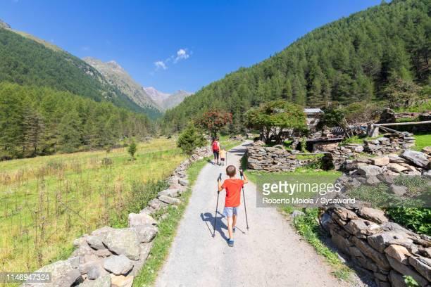 Family towards Rifugio Valmalza, Valcamonica, Italy
