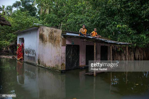 SATKHIRA KHULNA BANGLADESH A family trapped by the flood water at Tala in Satkhira Bangladesh is one of the countries most vulnerable to the effects...