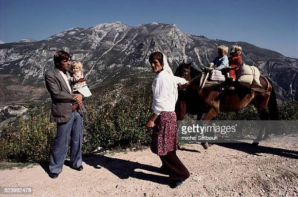 Family traveling on a mountain road between Shkodra and Tirane Albania | Location Between Shkodra and Tirane Albania