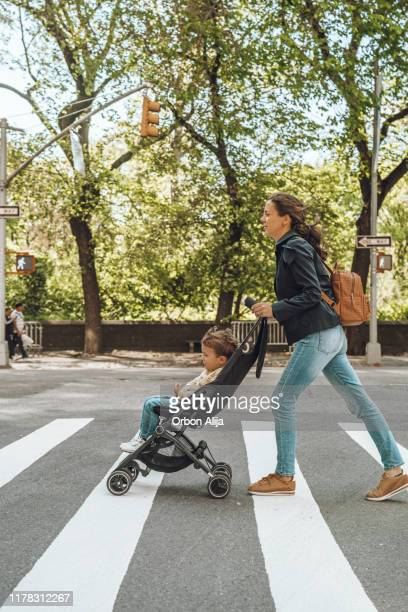 family travelling in new york - pushchair stock pictures, royalty-free photos & images
