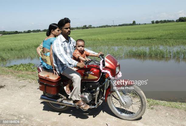 Family travelling on a motorcycle in Kishanganj, Bihar, India.