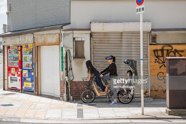 family travelling on bcycle in osaka japan