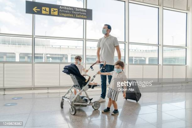 family travelling with face masks for covid-19 - barcelona spain stock pictures, royalty-free photos & images