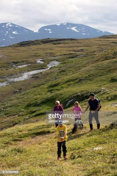 Family trekking in meadow