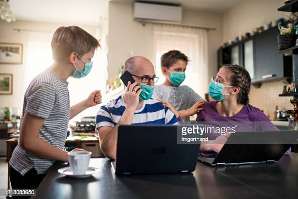 family trying to work and learn at home during covid-19 pandemic - adversidade imagens e fotografias de stock