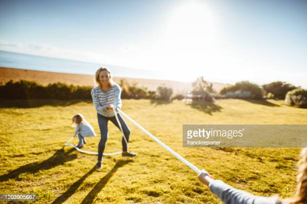 family tug of war in melbourne - sport venue stock pictures, royalty-free photos & images