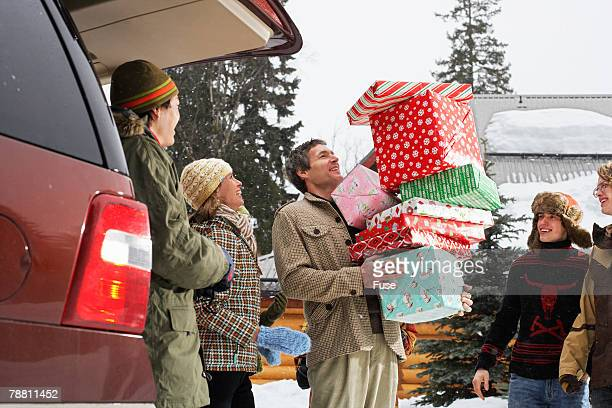 Family Unloading Christmas Gifts