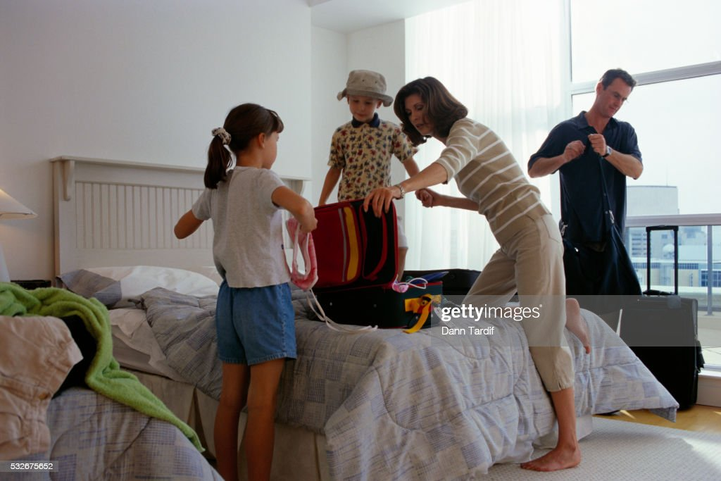 Family Unpacking in Hotel Room : Stock Photo