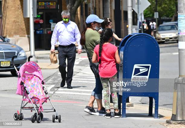 Family uses a mailbox on August 17, 2020 in Morristown, New Jersey. Postmaster General Louis DeJoy has accepted House Democrats' request to come...