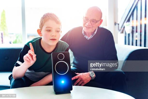 Family uses voice to control technology in their home with the help of a digital assistant