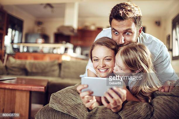 family using a phone - surfing the net stock pictures, royalty-free photos & images