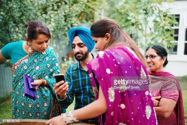 family using cell phone in backyard - palmerston north new zealand stock pictures, royalty-free photos & images