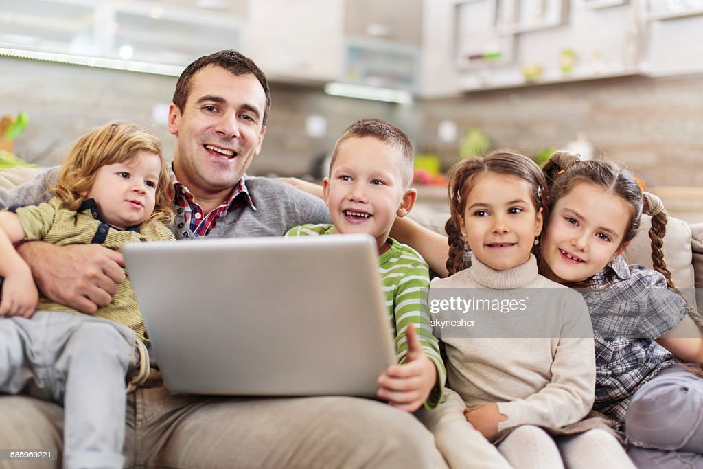 Family using computer. : Stock Photo