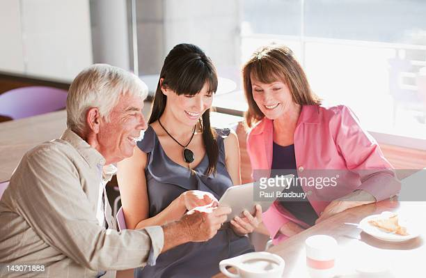 Family using laptop computer in cafe