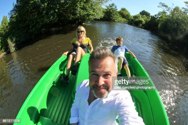 family using pedal boat at dulwich park, london - wide angle stock pictures, royalty-free photos & images
