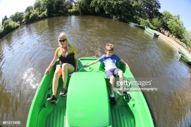 family using pedal boat at dulwich park, london - pedal boat stock pictures, royalty-free photos & images