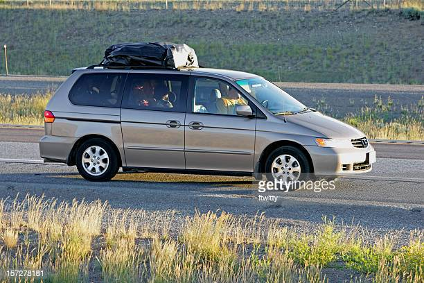 family vacation in a gray minivan - mini van stock photos and pictures