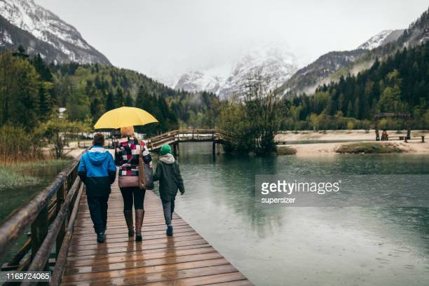 family vacation in slovenia - mother son shower stock photos and pictures
