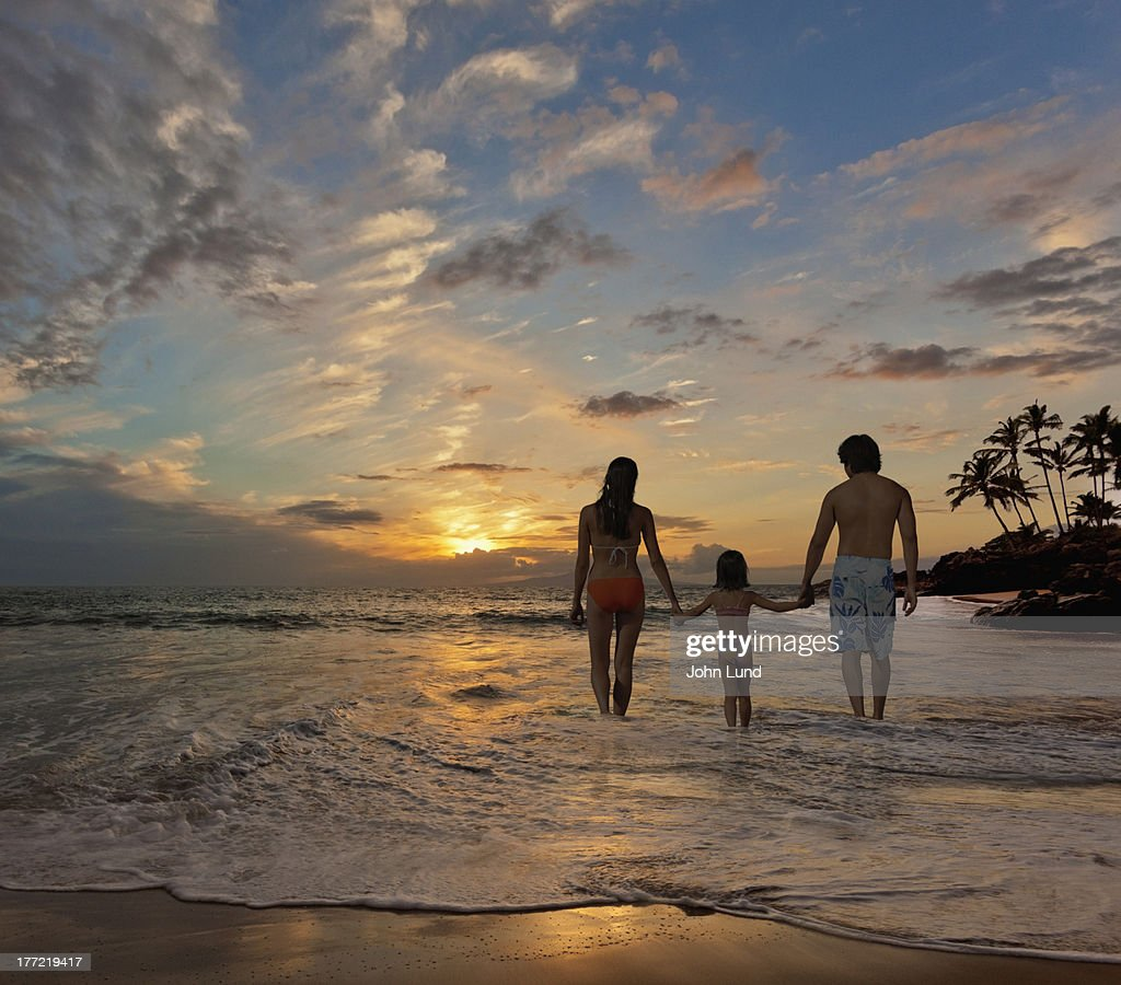 Family Vacation On A Tropical Beach Stock Photo
