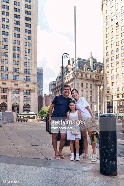 """family vacations in new-york, parents and child posing in street. - """"martine doucet"""" or martinedoucet stock pictures, royalty-free photos & images"""