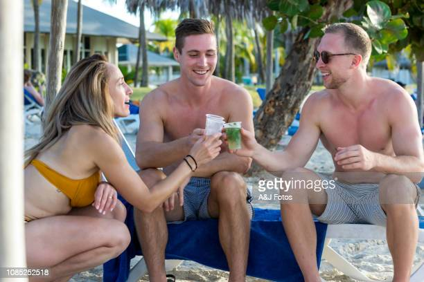 family vacations - gay men swimwear stock pictures, royalty-free photos & images