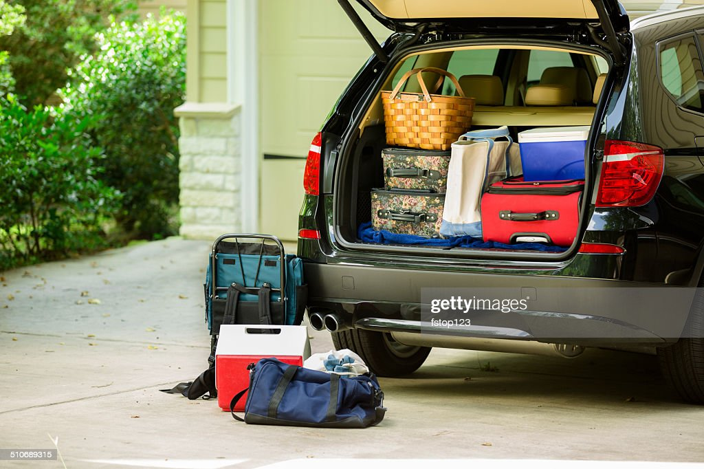 Family vehicle packed, ready for road trip, vacation outside home. : Stock Photo