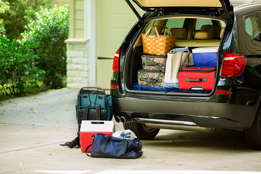 Family vehicle packed, ready for road trip, vacation outside home. 510689315