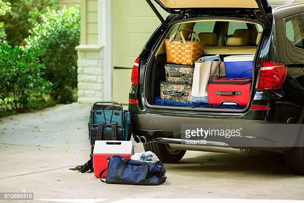 Family vehicle packed, ready for road trip, vacation outside home.