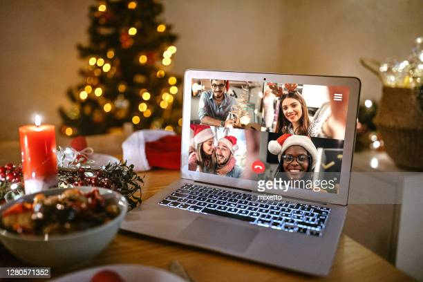 family video chatting online on the occasion of christmas celebration - father christmas stock pictures, royalty-free photos & images