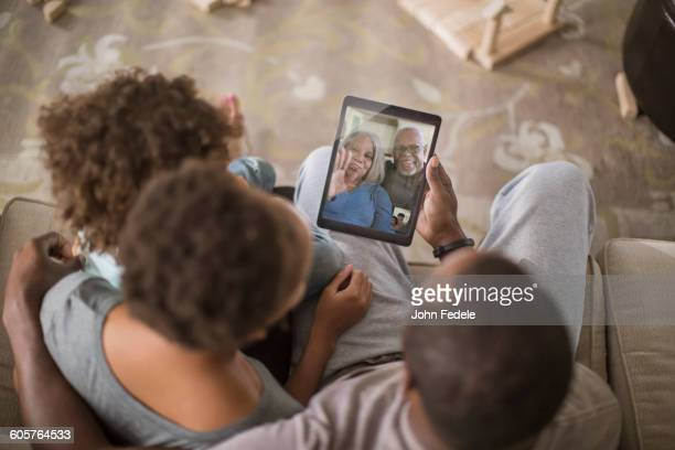 family video chatting with digital tablet - facetime stock pictures, royalty-free photos & images