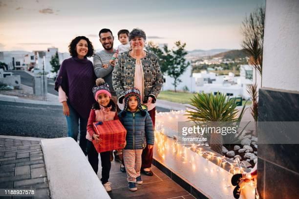 family visit on christmas eve - mexican christmas stock photos and pictures