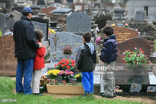 Family Visiting a Graveyard