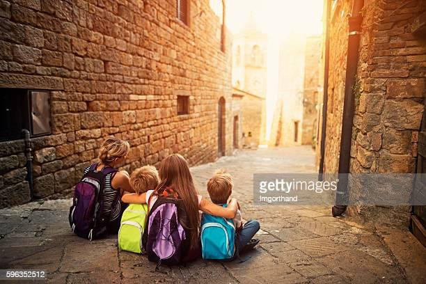 Family visiting beautiful Italian town